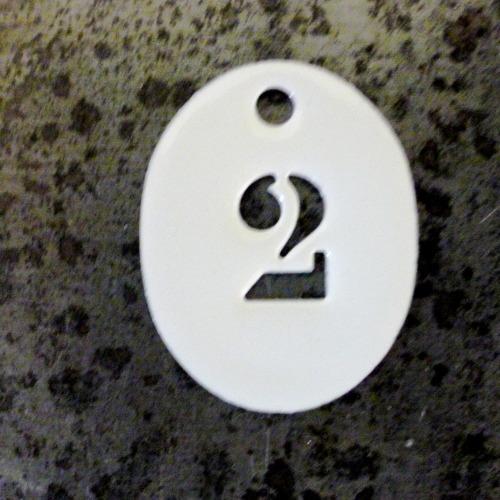 Jeton oval numéroté