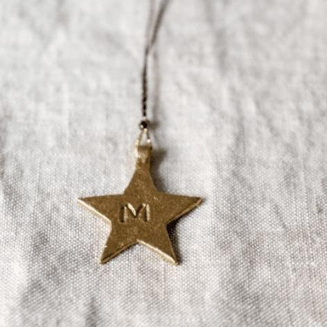 grigri étoile en laiton