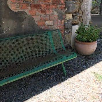 Banc de jardin en métal vintage